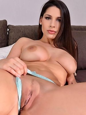 Zafira enjoys her anal plug on the sofa